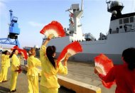 Women perform a dance as the Chinese frigate Yancheng comes in to dock at Limassol port, January 4, 2014. REUTERS/Andreas Manolis