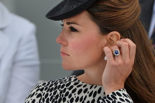 Britain's Catherine, Duchess of Cambridge attends a ship naming ceremony on June 13, 2013. Kate Middleton was the middle-class girl who made becoming a princess look easy -- but bringing up a royal baby will bring fresh challenges for Britain's glamorous future queen