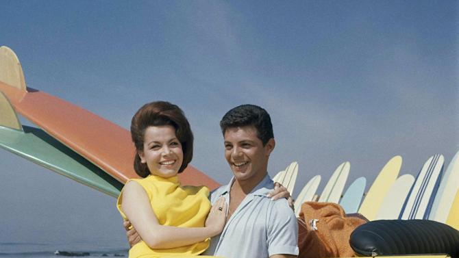 "FILE - In this 1963 file photo, singer Frankie Avalon and actress Annette Funicello are seen on Malibu Beach during filming of ""Beauty Party,"" in California in 1963. Walt Disney Co. says, Monday, April 8, 2013, that former ""Mouseketeer"" Funicello, also known for her beach movies with Avalon, has died at age 70. (AP Photo/File)"