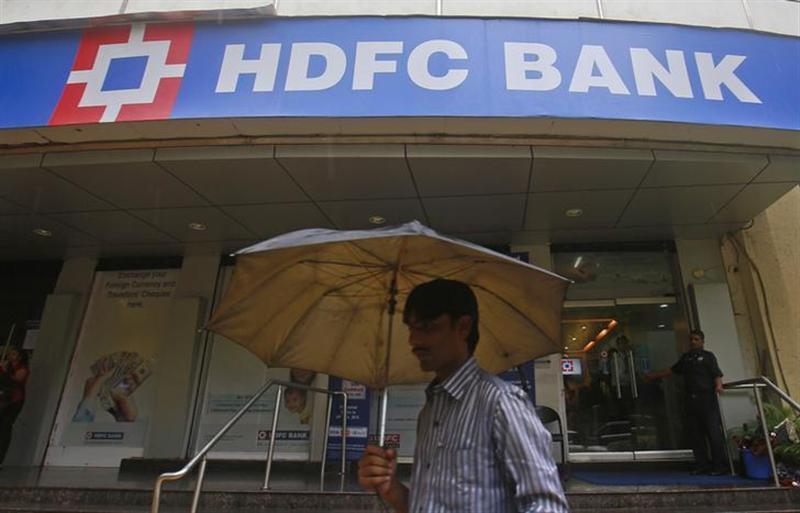 A customer walks outside an HDFC Bank branch in Mumbai July 17, 2013. REUTERS/Danish Siddiqui/Files