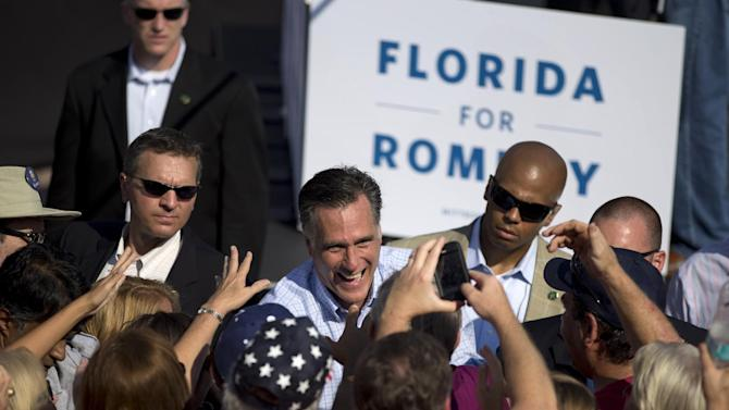 Republican presidential candidate, former Massachusetts Gov. Mitt Romney shakes hands during a campaign rally, Saturday, Sept. 1, 2012, in Jacksonville, Fla.  (AP Photo/Evan Vucci)