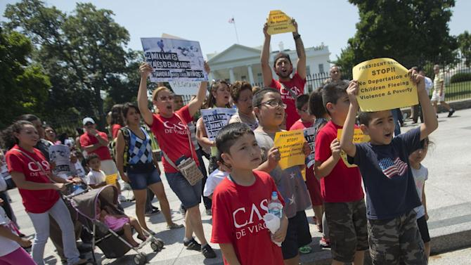 Demonstrators march in front of the White House in Washington, Monday, July 7, 2014, following a news conference of immigrant families and children's advocates responding to the President Barack Obama's response to the crisis of unaccompanied children and families illegally entering the US, A top Obama administration official says no one, not even children trying to escape violent countries, can illegally enter the United States without eventually facing deportation proceedings. But Homeland Security Sec Jeh Johnson basically acknowledged Sunday that such proceedings might be long delayed, and he said that coping with floods of unaccompanied minors crossing the border is a legal and humanitarian dilemma for the US. (AP Photo/Pablo Martinez Monsivais)
