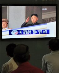 "<p>South Korean men in Seoul watch a TV report about the title of 'Marshal' awarded to North Korea's leader Kim Jong-Un. North Korea's threat of a nuclear review came after the North arrested a man who was allegedly trying to blow up a monument to Kim Il-Sung, an act which the foreign ministry described as a ""war action as serious as the armed invasion"".</p>"