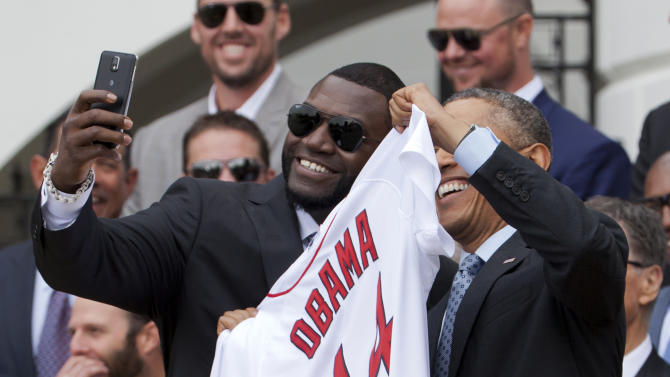 "Boston Red Sox designated hitter David ""Big Papi"" Ortiz, left, takes a selfie with President Barack Obama, holding a Boston Red Sox jersey presented to the president during a ceremony on the South Lawn of the White House in Washington, Tuesday, April 1, 2014, where the president honored the 2013 World Series baseball champion Boston Red Sox. (AP Photo/Manuel Balce Ceneta)"