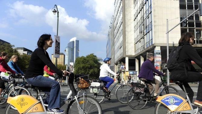 "People ride their bicycles as the city centre is transformed into a car-free zone for the day as part of ""Mobility Week"" in Brussels"