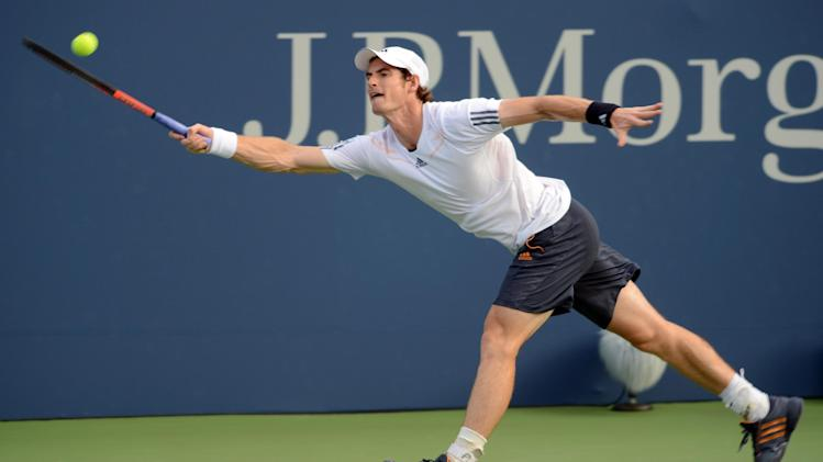 Andy Murray of Great Britain reaches for the ball in his match against Marin Cilic, of Croatia, in the quarterfinals of the 2012 US Open tennis tournament, Wednesday, Sept. 5, 2012, in New York. (AP Photo/Henny Ray Abrams)