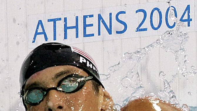 FILE - In this Aug. 15, 2004 file photo, Michael Phelps of the U.S. reacts after finishing in a semifinal heat of the 200m freestyle at the 2004 Olympic Games in Athens, Greece. Phelps retires with twice as many golds as any other Olympian, and his total of 22 medals is easily the best mark, (AP Photo/Thomas Kienzle, File)