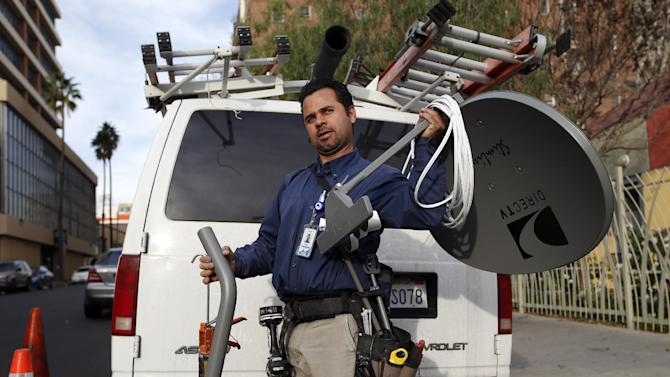 Cesar Ramirez, a subcontractor for DirecTV, gets ready to install a DirecTV satellite dish in Los Angeles, Tuesday, Jan. 22, 2013. Contract workers, consultants, freelancers or the self-employed face additional challenges at tax-filing time. (AP Photo/Jae C. Hong)