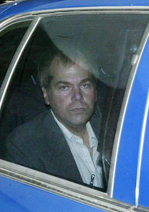 FILE - In this Nov. 18, 2003 file photo, John Hinckley Jr. arrives at U.S. District Court in Washington. A judge has ruled that the man who attempted to assassinate President Ronald Reagan will get to spend more time outside a mental hospital where he has been confined for most of the past three decades. Hinckley will be allowed to visit his mother's home in Williamsburg, Va., for up to 17 days at a time. Hinckley has been allowed to spend increasing amounts of time at his mother's house in recent years, but previous visits were capped at 10 days. (AP Photo/Evan Vucci, File)