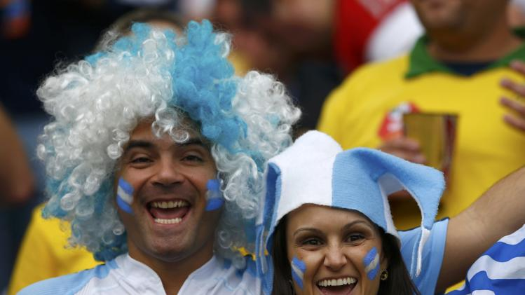 Argentina fans pose before the 2014 World Cup Group F soccer match between Argentina and Nigeria at the Beira Rio stadium