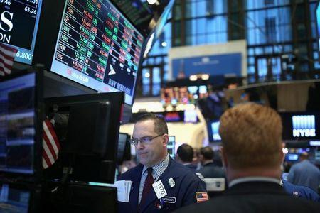 A trader works on the floor of the New York Stock Exchange in Manhattan, New York City