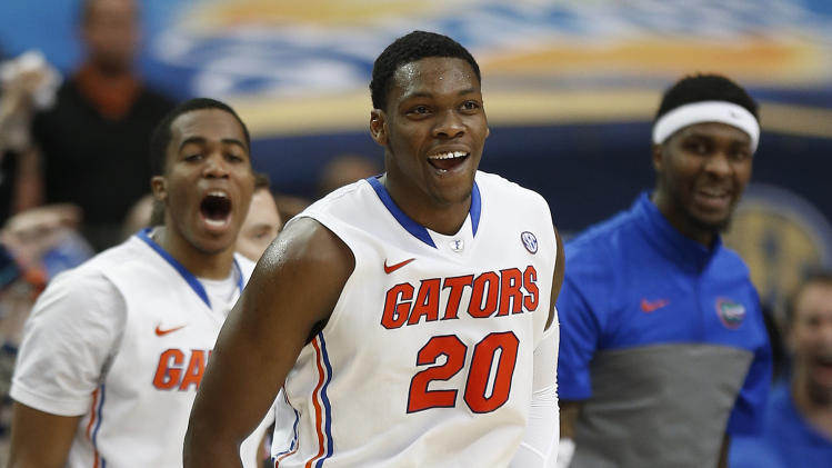 Florida guard Michael Frazier II (20) reacts to play against Tennessee during the second half of an NCAA college basketball game in the semifinal round of the Southeastern Conference men's tournament, Saturday, March 15, 2014, in Atlanta. (AP Photo/John Bazemore)