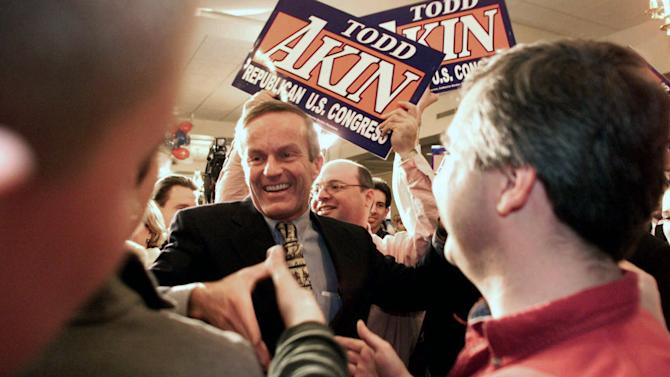 "FILE - In this Nov. 7, 2000 file photo, Missouri 2nd District candidate state Rep. Todd Akin, R-Mo., is congratulated by his supporters upon his victory over Sen. Ted House,  D-St. Charles in Kansas City, Mo. Until this week, Rep. Todd Akin was virtually unknown beyond his district, associated more with his deep religious convictions than any legislative achievements. Long before his comments about women's bodies and ""legitimate rape"" made him a flashpoint in the fall campaign, this congressional backbencher was a favorite among home-schooling organizations and conservative church groups.  (AP Photo/St. Louis Post-Dispatch, Karen Elshout)"