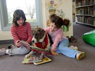 kids reading with dogs