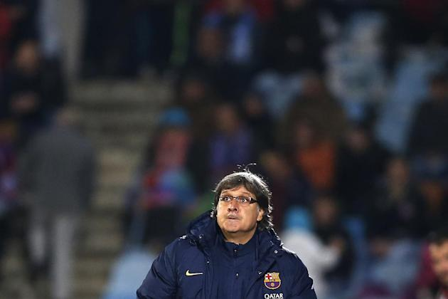 FC Barcelona's coach Gerardo 'Tata' Martino from Argentina looks up during a Spanish La Liga soccer match between FC Barcelona and Getafe at the Coliseum Alfonso Perez stadium in Madrid, S