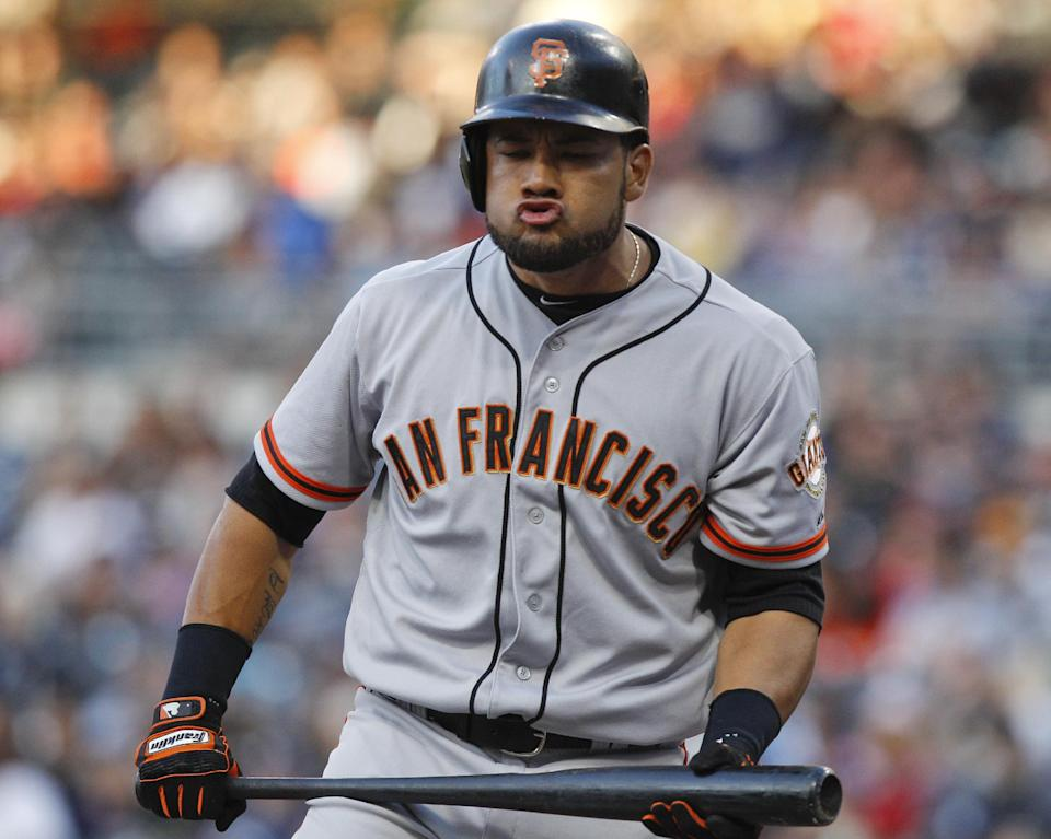 San Francisco Giants' Melky Cabrera reacts after striking out during the first inning against the against the San Diego Padres in a baseball game Tuesday, June 5, 2012, in San Diego. (AP Photo/Lenny Ignelzi)