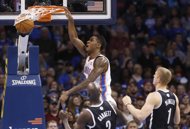 Oklahoma City Thunder forward Perry Jones (3) dunks in front of Brooklyn Nets center Kevin Garnett and forward Mason Plumlee (1) in the second quarter of an NBA basketball game in Oklahoma City, Thurs