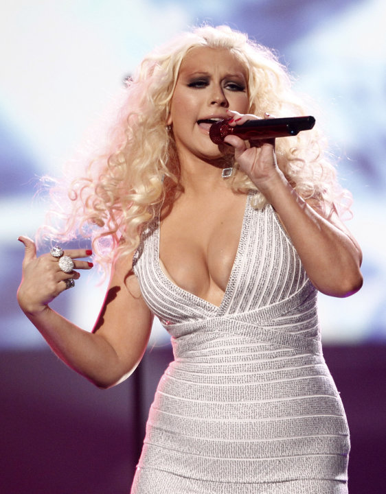 FILE - This Nov. 20, 2011 file photo shows Christina Aguilera performing at the 39th Annual American Music Awards in Los Angeles. Aguilera is comparing her upcoming album to a