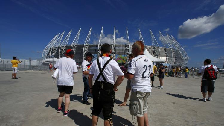 Germany fans walk to the stadium before the 2014 World Cup Group G soccer match between Germany and Ghana at the Castelao arena