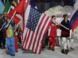 United States' Julie Chu, right, carries her nation's…