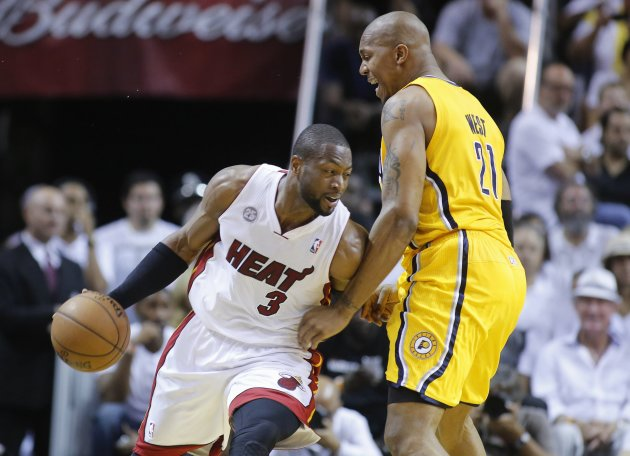 Miami Heat's Wade drives on Indiana Pacers' West during Game 2 of their NBA Eastern Conference final basketball playoff in Miami