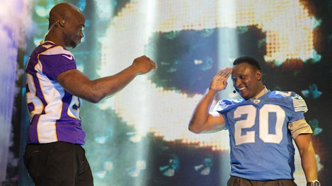 IMAGE DISTRIBUTED FOR EA SPORTS - NFL hall of fame running back Barry Sanders, right, salutes Minnesota Vikings running back Adrian Peterson, left, during the EA Sports Madden NFL 25 Cover Reveal on SportsNation on Wednesday, April, 24, 2013 in New York. (Photo by Chris Park/Invision for EA Sports/AP Images)