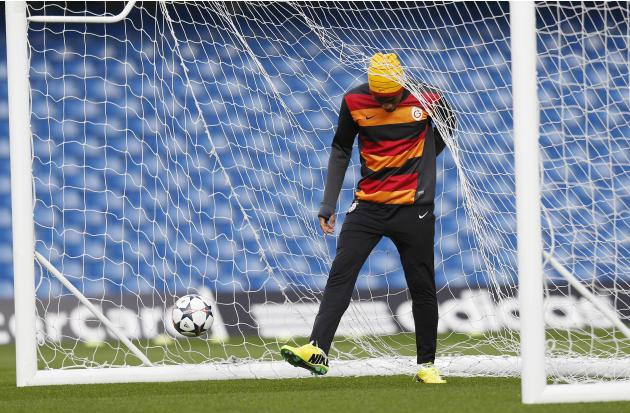Galatasaray's Drogba kicks balls out of the goal during a training session at Stamford Bridge in London