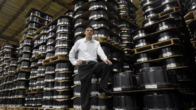 """In this Friday, Jan. 11, 2013, photo, Webb Wheel Products President Duane Ricketts is pictured in front a portion of their inventory of brake drums in Cullman, Ala. """"Everyone is waiting for the unemployment rate to drop, but I don't know if it will much,"""" Ricketts says. """"Companies in the recession learned to be more efficient, and they're not going to go back."""" (AP Photo/Dave Martin)"""