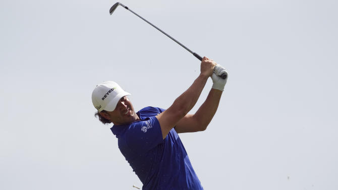Scott Piercy follows his drive off the 17th tee during the first round of the Sony Open golf tournament on Thursday, Jan. 10, 2013, in Honolulu. (AP Photo/Marco Garcia)