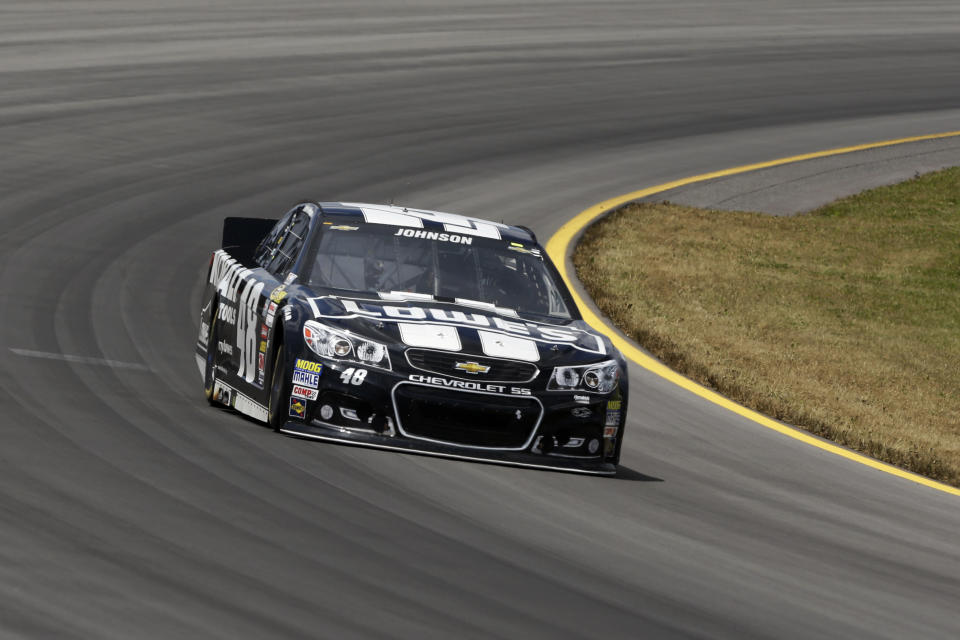 Jimmie Johnson drives through Turn 3 during the NASCAR Pocono 400 auto race on Sunday, June 9, 2013, in Long Pond, Pa. (AP Photo/Mel Evans)