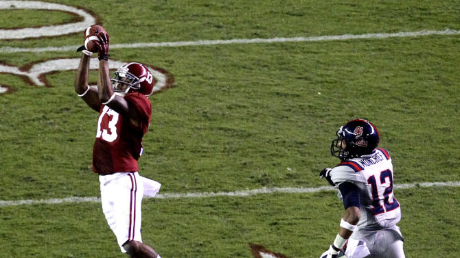 Alabama defensive back Deion Belue (13) intercepts a pass intended for Mississippi wide receiver Donte Moncrief (12) during the first half of an NCAA college football game Saturday, Sept. 29, 2012, in Tuscaloosa, Ala. (AP Photo/ Butch Dill)