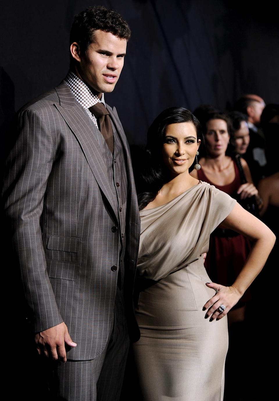 FILE - In this Aug. 31, 2011 file photo, newlyweds Kim Kardashian and Kris Humphries attend a party thrown in their honor at Capitale in New York. The couple married on Aug. 20 in a star-studded, black-tie ceremony. The marriage lasted 72 days. (AP Photo/Evan Agostini, file)