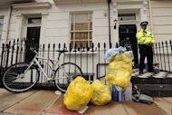 A policeman guards the entrance to a flat where the body of Gareth Williams was discovered in a bag in 2010. The British spy was probably unlawfully killed, a coroner has concluded on the final day of day of the inquest into his death