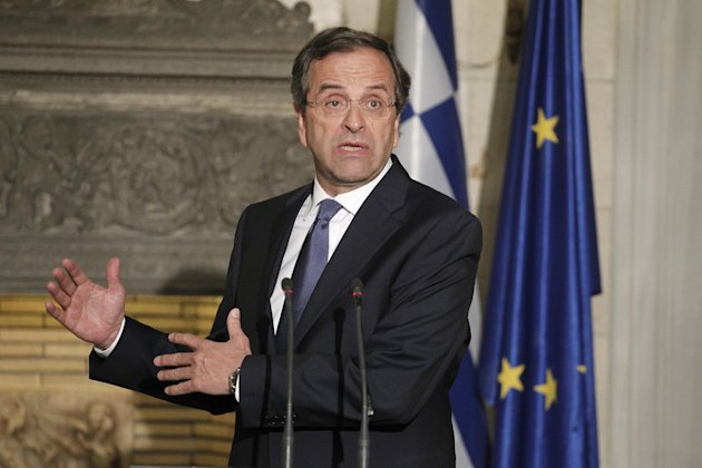 Greek Prime Minister Antonis Samaras, speaks next to Jean Claude Juncker, unseen, prime minister, of Luxembourg and President of Eurogroup during a joint news conference after their meeting in Athens, Wednesday, Aug. 22, 2012. The meeting is the first of several Samaras will hold this week with European leaders to press the case for granting Athens more time to complete its reforms. He will be in Berlin on Friday to speak with German Chancellor Angela Merkel and in Paris on Saturday with French President Francois Hollande. (AP Photo/Petros Giannakouris)