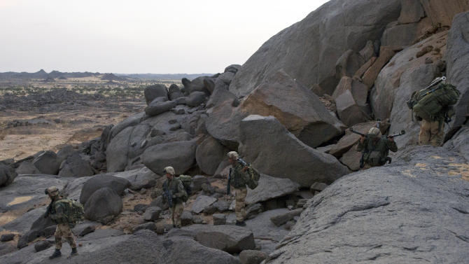 This photo taken March 1, 2013 and released on Tuesday  March 5, 2013, by the French Army Communications Audiovisual office (ECPAD) shows French soldiers from the 2e REP legionnaires regiment patrolling in the desert in Northern Mali. France said Monday for the first time that a key al-Qaida leader in Mali is probably dead. An activist close to the terror network's north Africa branch was also reported to have confirmed the death of Algerian-born warlord Abou Zeid.(AP Photo/Ghislain Mariette/ECPAD)