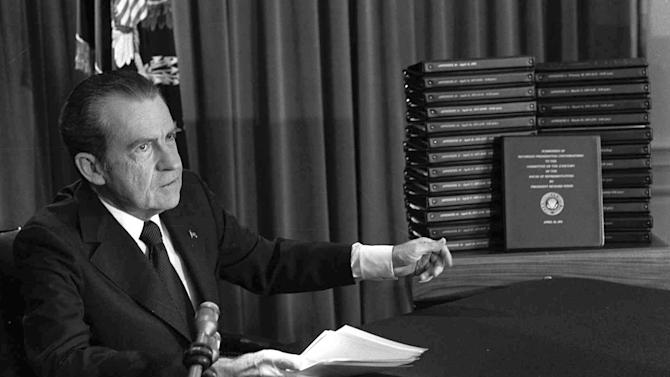 FILE - In this April 29, 1974, file photo, President Richard M. Nixon points to the transcripts of the White House tapes after he announced during a nationally-televised speech that he would turn over the transcripts to House impeachment investigators, in Washington. The last 340 hours of tapes from Nixon's White House were released Wednesday, Aug. 21, 2013, along with more than 140,000 pages of text materials. (AP Photo/File)