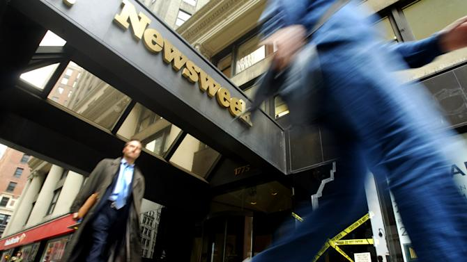 FILE- In this Monday, May 16, 2005, file photo, pedestrians walk past the Broadway entrance to the Newsweek. building in New York. Newsweek announced Thursday, Oct. 18, 2012 that it will end its print publication after 80 years and shift to an all-digital format in early 2013. Its last U.S. print edition will be its Dec. 31 issue. The paper version of Newsweek is the latest casualty of a changing world where readers get more of their information from websites, tablets and smartphones. It's also an environment in which advertisers are looking for less expensive alternatives online. (AP Photo/Mary Altaffer)