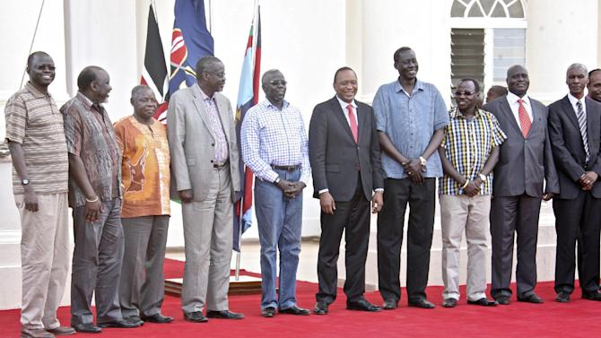 """In this photo released by the Kenya Presidency, Kenya's President Uhuru Kenyatta, center, receives seven of the 11 leaders accused of plotting a failed military coup in South Sudan in December, after they were flown to Kenya where they will still be held in custody according to a spokesman for South Sudan's president, in Nairobi, Kenya Wednesday, Jan. 29, 2014. South Sudan's Justice Minister Paulino Wanawilla Unago said the detainees will be in Kenya for the duration of the investigation """"for their own safety"""" but will return to face trial. At 2nd right is retired Kenyan General Lazaro Sumbeiywo and Director-General of Kenya's National Security Intelligence Service (NSIS) Michael Gichangi, is at far right. (AP Photo/Kenya Presidency)"""