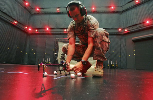 U.S. Air Force First Lieutenant Greg Sundbeck prepares a computer controlled military drone for a test flight in the microaviary lab at Wright Patterson Air Force Base in Dayton Ohio in this file phot