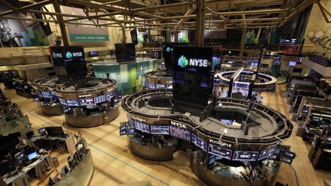 FILE - In this Monday, Oct. 29, 2012 file photo, the floor of the New York Stock Exchange is empty of traders, as New York's financial district braces for the onslaught of Hurricane Sandy. U.S. markets will remain closed Tuesday, Oct. 30, but the New York Stock Exchange said that despite reports that its historic trading floor suffered irreparable damage, no such damage has occurred and that contingency plans are being tested only as a safety measure. Futures trading will go on until 9:15 a.m. Eastern, but volume is light. (AP Photo/Richard Drew, File)