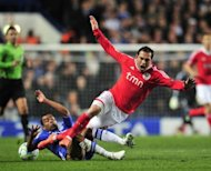 Chelsea's Ashley Cole (L) vies with Benfica's Bruno Cesar during their UEFA Champions League quarter finals football match at Stamford Bridge, West London. Chelsea survived a nervous finale against 10-man Benfica to earn a 2-1 win in the Champions League quarter-final second leg and set up a last-four showdown with holders Barcelona