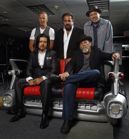 This June 5, 2012 photo shows the musical group the Mavericks, clockwise from top left, Paul Deakin, Raul Malo, Jerry Dale O'Connell, Robert Reynolds and Eddie Perez in Nashville, Tenn. The group will perform ay the CMA Music Fest on Sunday, June 10. (Photo by Wade Payne/Invision/AP)