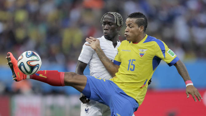 Ecuador's Michael Arroyo kicks the ball away in front of France's Bacary Sagna during the group E World Cup soccer match between Ecuador and France at the Maracana Stadium in Rio de Janeiro, Brazil, Wednesday, June 25, 2014. (AP Photo/Bernat Armangue)