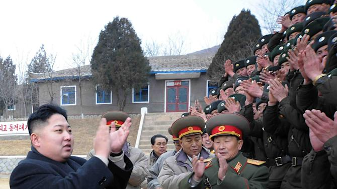 FILE - In this Jan. 1, 2012 file photo released by Korean Central News Agency and distributed by Korea News Service, North Korea's new leader Kim Jong Un, left, applauds with military personnel as he inspects Seoul Ryu Kyong Su 105 Guards Tank Division of the Korean People's Army at an undisclosed location in North Korea to congratulate servicepersons on New Year's day.  North Korean state media made the announcement Wednesday, July 18, 2012 in a special bulletin that Kim has been promoted to marshal, the military's highest rank. (AP Photo/Korean Central News Agency via Korea News Service, File)