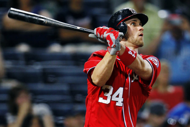 FILE - In this May 27, 2012, file photo, Washington Nationals' Bryce Harper (34) follows through with a solo home run in the eighth inning of a baseball game against the Atlanta Braves in Atlanta.