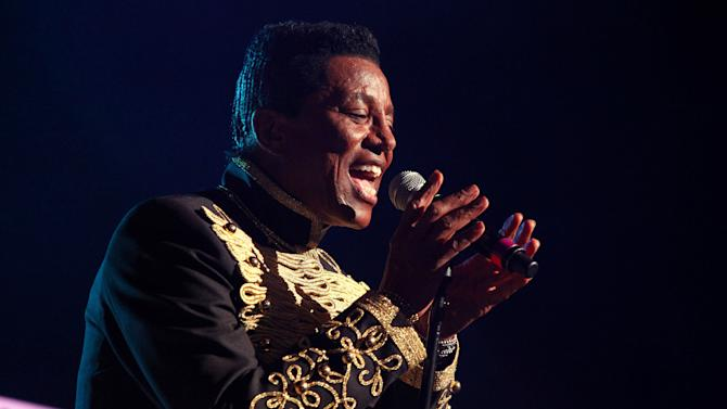 """FILE - In this June 22, 2012 file photo, Jermaine Jackson performs with The Jacksons on their Unity Tour 2012 at Star Plaza in Merrillville, IN.  Court records in Los Angeles show Jackson filed a petition on Nov. 6, 2012 to change his famous last name to Jacksun, citing only """"artistic reasons."""" (Photo by Barry Brecheisen/Invision/AP, File)"""