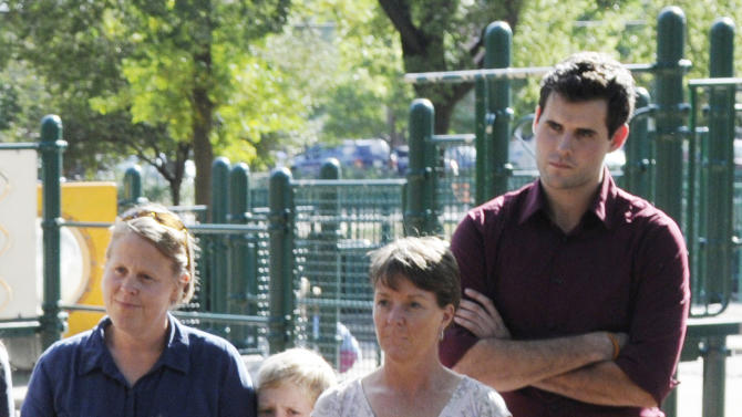 Zach Wahls, right, joins Minneapolis area families at a Vote No picnic Wednesday, Sept. 5, 2012 to discuss how the proposed Minnesota constitutional marriage amendment would have a negative impact on Minnesota families and limit the freedom to marry for same-sex couples. Wahls, an Iowan who was raised by a lesbian couple, stands alongside a lesbian couple, Mary Gustafson, left, and Jenny Simonds and sons Charlie, left, and Carter Gustafson. Wahls is scheduled to address the Democratic National Convention. (AP Photo/Jim Mone)