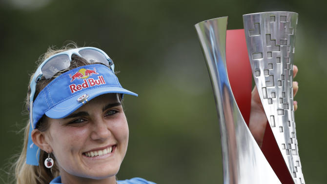 Lexi Thompson of the US holds her trophy aloft after winning the Malaysian LGPA event in Kuala Lumpur, Sunday, Oct. 13, 2013. (AP Photo/Mark Baker)