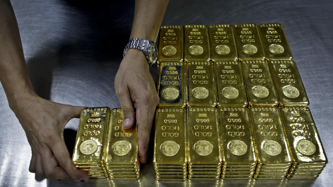 In this Tuesday Oct. 9, 2012 photo, technician prepares 1 Kg  gold bars of 995.0 purity to pack for delivery at the Emirates Gold company in Dubai, United Arab Emirates. Some traders predict prices could once again rise toward the record high of nearly $1,900 an ounce, as central governments and investors look to gold as a safe bet in the unsteady world economy. (AP Photo/Kamran Jebreili)