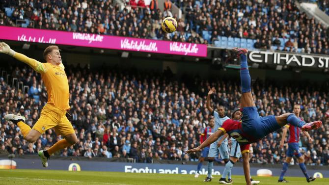 Manchester City's Joe Hart saves a shot from Crystal Palace's Fraizer Campbell during their English Premier League soccer match at the Etihad Stadium in Manchester